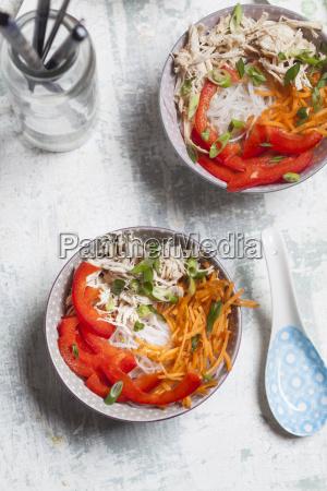 glass noodle salad in bowl vegetables