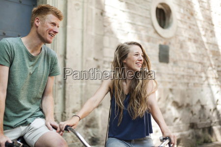 couple with bicycles in front of