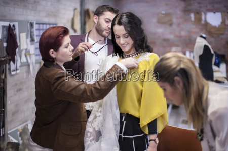 taking measurements for client in fashion