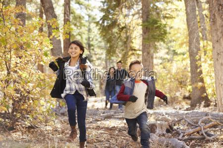 parents watching their children running in