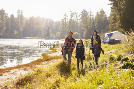 parents and two children on camping