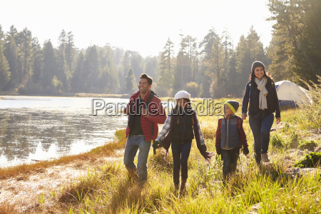 parents and two children walking near