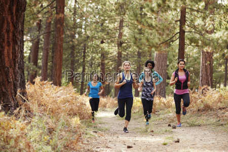 group of young adult women running