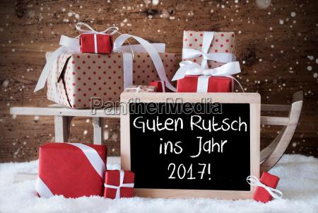 sleigh with gifts snowflakes guten rutsch