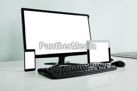 computer desktop with digital tablet and