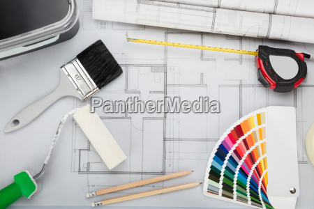 blueprint with tools and equipment on