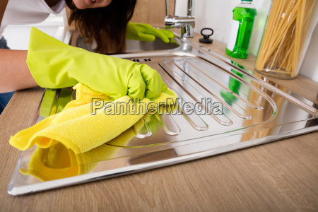 close up of woman cleaning stainless