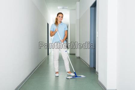 female janitor cleaning the floor with