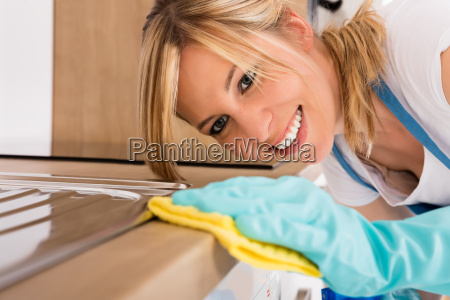 close up of woman cleaning kitchen