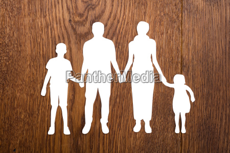family papercut on wooden desk