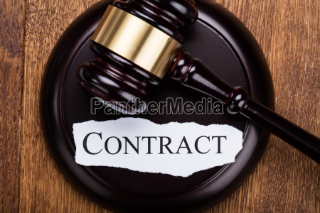 contract word written on gavel