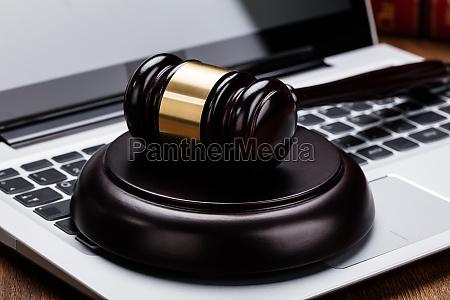 judge gavel on laptop keyboard