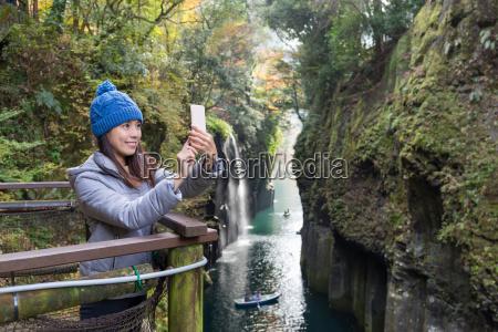 woman taking selfie by cellphone in