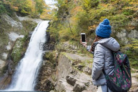 woman taking photo on akiu great