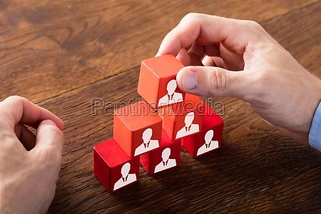 block of team on wooden desk