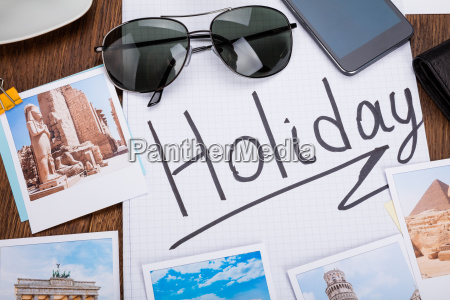 photos of holiday on wooden desk