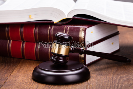 gavel with books on wooden desk