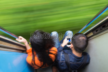 couple traveling by train motion blured