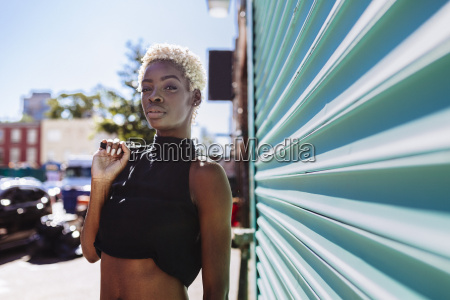 confident young woman standing at roller