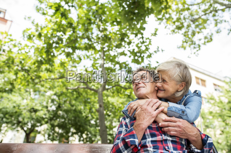senior couple watching something