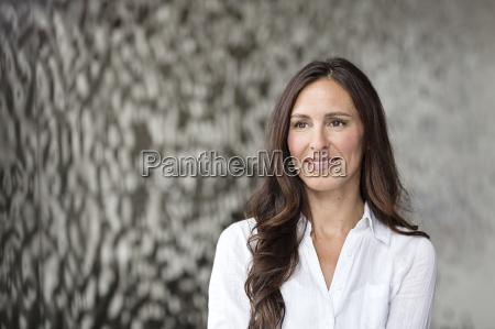 portrait of confident businesswoman in front