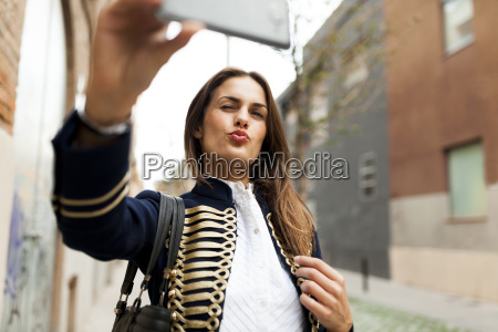 fashionable young woman taking a selfie