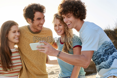 happy friends with cell phone on
