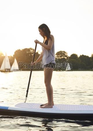 germany hamburg young woman on paddleboard