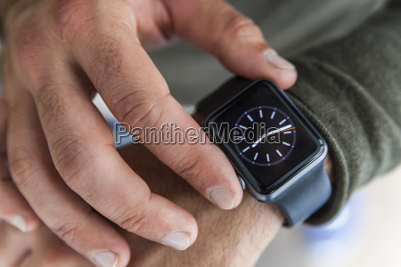 businessman with smartwatch close up