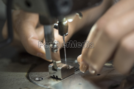 seamstress working at sewing machine close