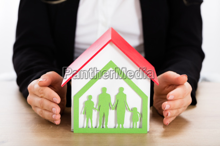 house model with papercut family house