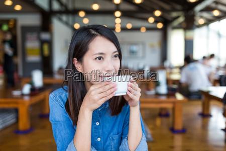 woman enjoy her coffee