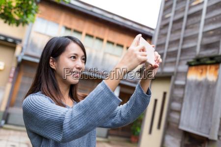 woman taking photo in kanazawa city