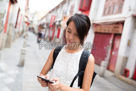 woman using cellphone in macao