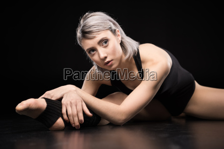 attractive young sporty woman dancer stretching