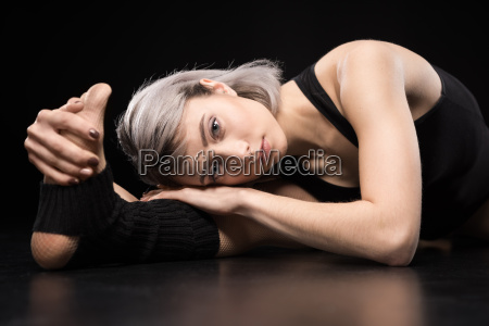 attractive sporty young woman dancer stretching