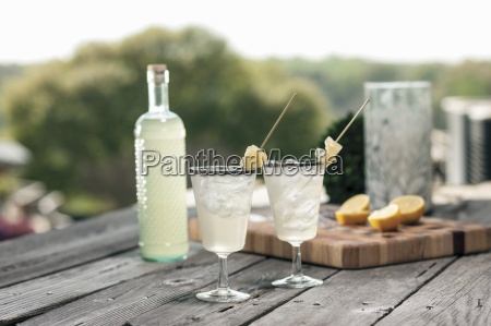 bottled gin punch with pineapple garnish