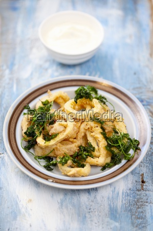 baked squid rings with fried parsley