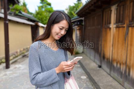 woman looking at cellphone at kanazawa
