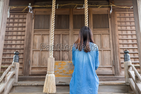 back view of woman ringing the