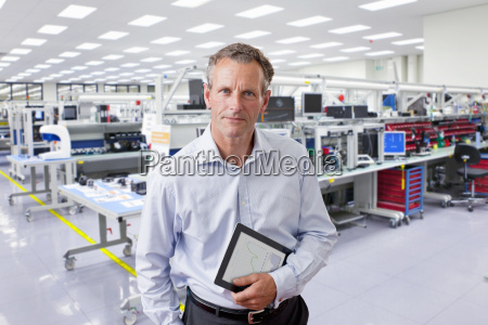 businessman on factory floor of electronics
