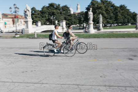 italy padua two young tourists riding