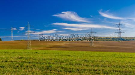 power pylons between fields