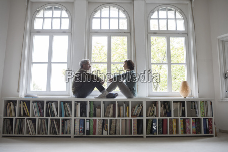 mature couple sitting at the window