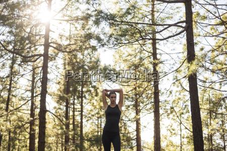 female runner training on country road