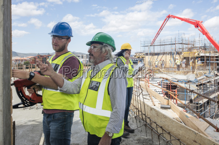 engineer inspecting construction site talking to