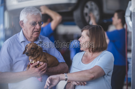 elderly couple with dog in mechanical