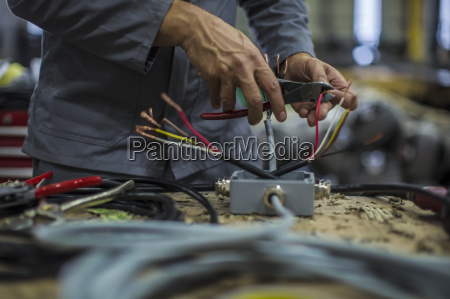 close up of mechanics hands in