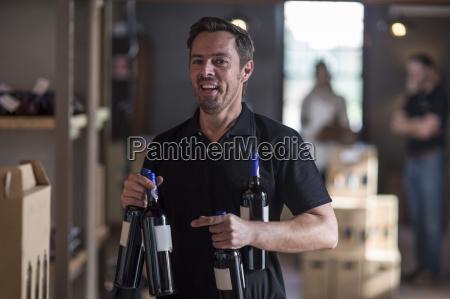 portrait of smiling man holding wine