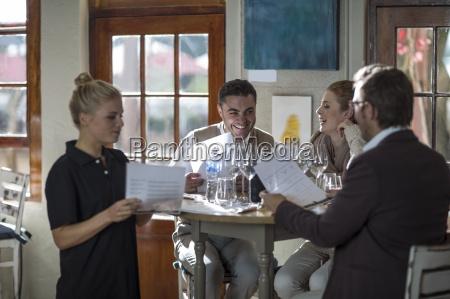 waitress serving group of customers at
